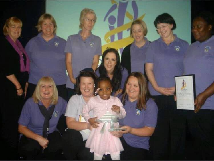 Children's Hospital Pyjamas CEO's daughter, with a team of nurses, after winningCroydon's Child of Courage award 8 years ago!