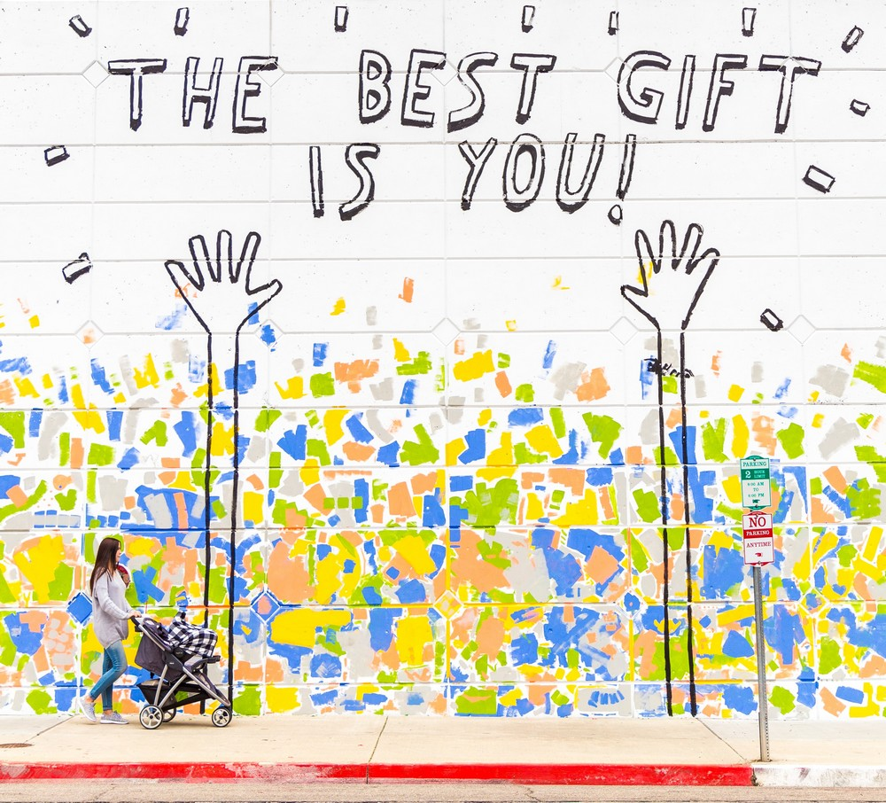 graffiti sign reading 'the best gift is you'