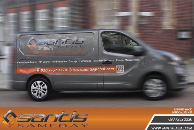 santis delivery service logo pictured on grey van