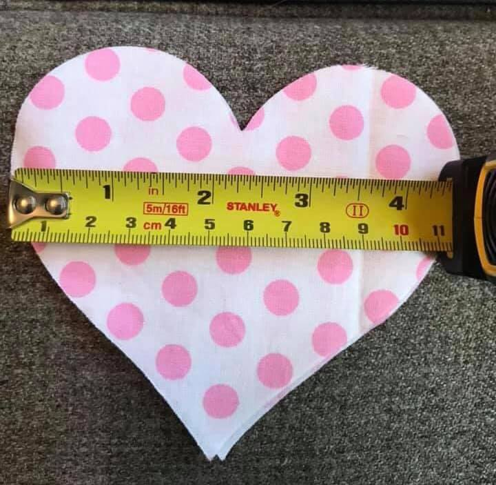 a material heart with measuring tape.